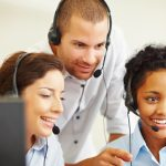 Happy group of call centre employees at work